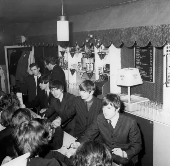 The Beatles signing autographs at Wimbledon Palais, London, 14 December 1963