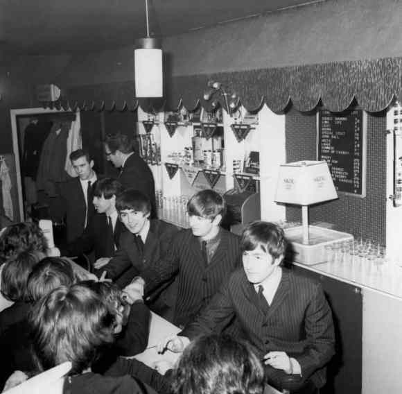 The Beatles signing autographs at Wimbledon Palais, London, 14 December 1963