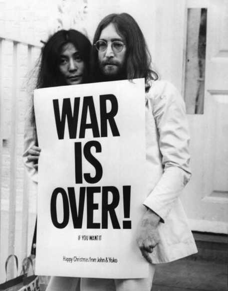 John Lennon and Yoko Ono with a War Is Over! poster, December 1969