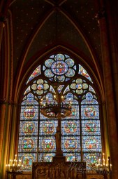 A stained glass window of Notre-Dame, south side chapel.