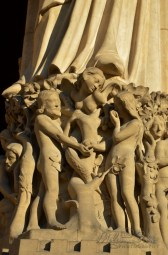 The story of the Eden Garden. The temptation of Adam & Eve by the devil. Pedestal of the statue of Madonna with Child, western portal (of the Virgin), of Notre-Dame de Paris, France