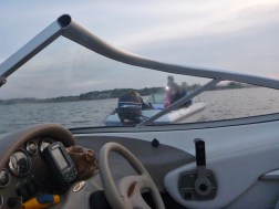 getting beached in the unmarked channel... getting a tow by some friendly islanders