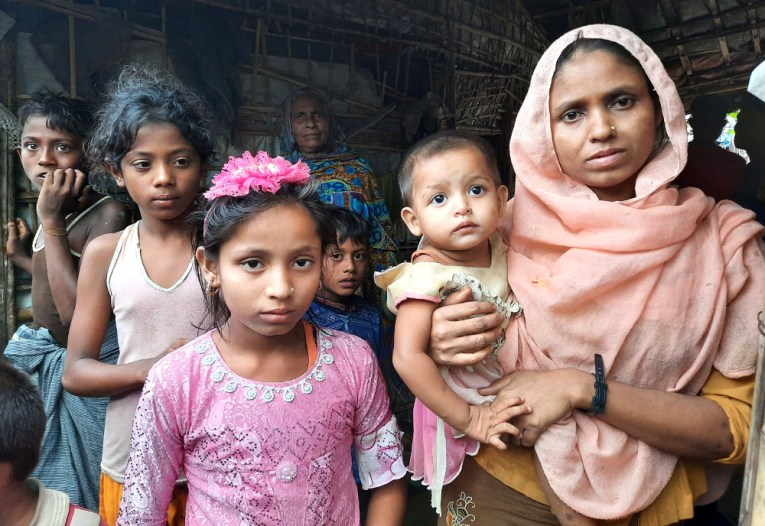 Taslima Akter (front left), a 9-year-old Rohingya girl, stands beside her mother at the Baharchara refugee camp in Cox's Bazar, Bangladesh, Aug. 16, 2020. [Sunil Barua/BenarNews]