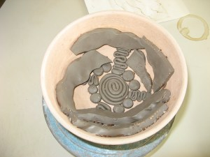press mould being filled with clay