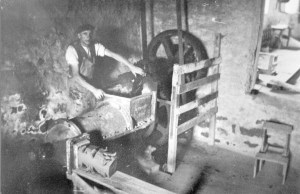 Charlie Armour pugging clay at Waterside pottery in 1940.