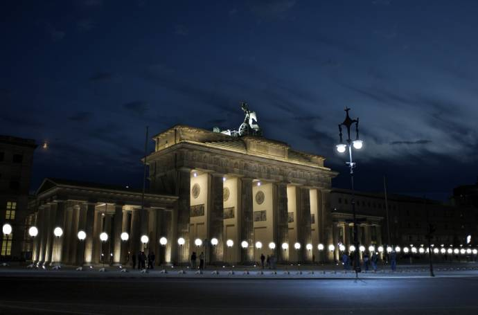 Glowing balloons lined up at the Brandenburg Gate where the Berlin Wall used to be