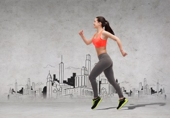 fitness, sport, exercising and dieting concept - beautiful sporty woman running in front of the city drawing