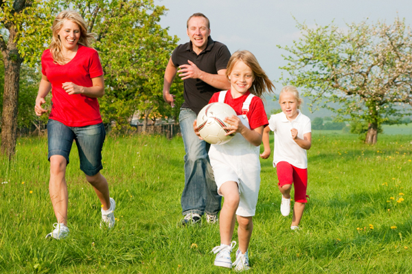 family-running-with-soccer-ball