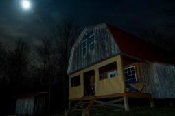 Cabin under moonlight