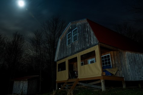 Cabin under moonlight