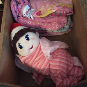 Silverbells sleeping in a drawer of pajamas