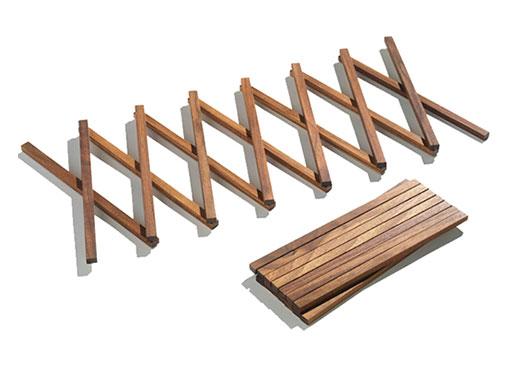 concertina wood trivet accessories better living through design. Black Bedroom Furniture Sets. Home Design Ideas