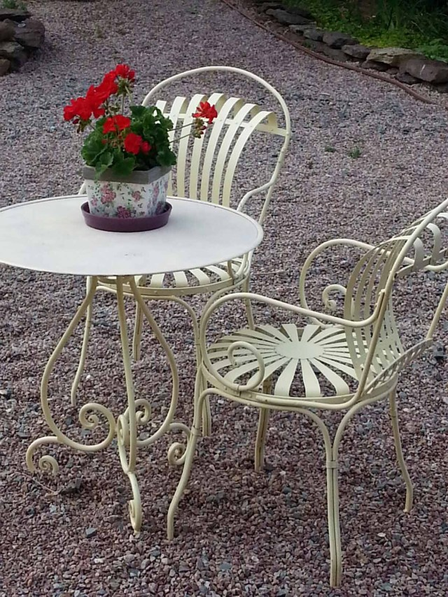 Picturesque scene of flowers and table at Iffendic accommodation