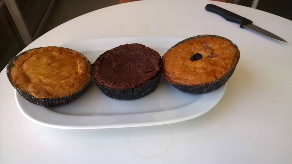 Photograph of three Gateaux Basques cakes on a plate.