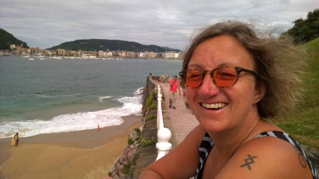 Photograph of Sarah laughing on the promenade at Biarritz, France.