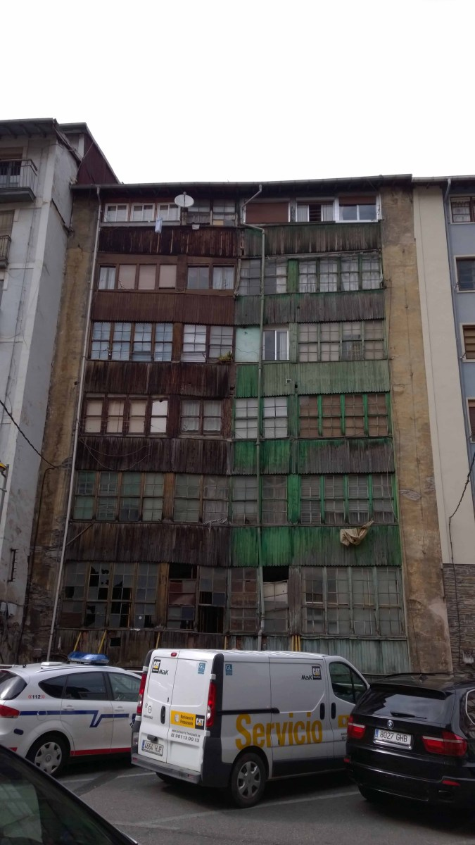 Photograph of a multi-storey run down building in Eiber, Basque Country, Spain.