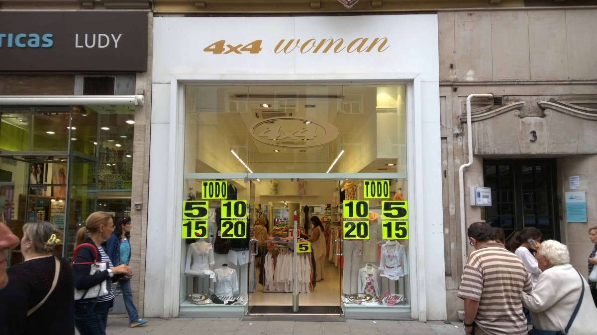 Photograph of a Santander, Spain shop sign saying '4 by 4 Woman'.