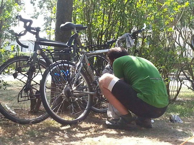Photograph of Keith doing some bicycle maintenance.