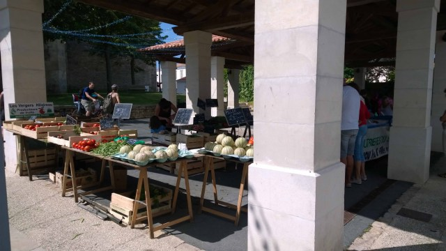 Photograph of French market stalls with produce