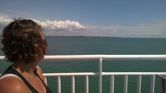Photograph of Sarah on the Royan ferry looking out to sea across the estuary.