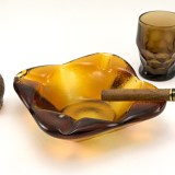 Organic style vintage art glass ashtray weighs almost four pounds. Made of thick beautiful amber colored glass. Large size makes it perfect for cigars, patio, poolside or parties.