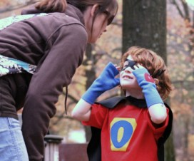 mom talking to superhero son