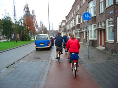 Bike path separated from the roadway via parked cars and medians in Groningen, Netherlands. Image Credit: Zachary Shahan / Bikocity
