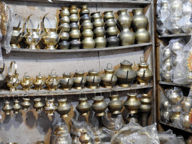 Brass puja items dot a store