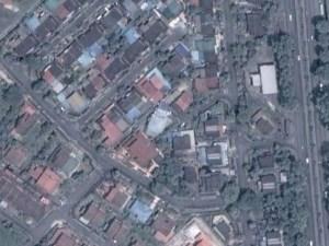 Surau Al-Hidayah is the pale blue building in the center