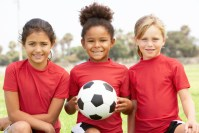 Three young girls on a soccer team