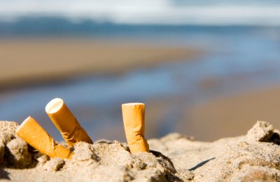 three cigarettes on beach