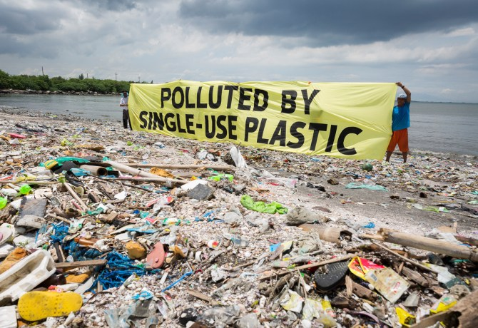 "Greenpeace together with the #breakfreefromplastic coalition conduct a beach cleanup activity and brand audit on Freedom Island, Parañaque City, Metro Manila, Philippines. The activity aims to name the brands most responsible for the plastic pollution happening in our oceans. A banner reads ""Polluted by Single-use Plastic"".  Freedom island is an ecotourism area which contains a mangrove forest and swamps providing a habitat for many migratory bird species from different countries such as China, Japan and Siberia."