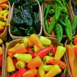 Peppers produce a variety of natural pesticides, including capsaicin. Peppers by James Walsh via Flickr.