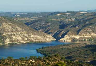 A distant view of part of the old village of Faió half emerged in the River Ebro