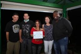 Merlis receives her certificate. (photo by Ernesto Reyes)