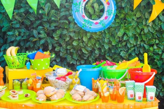 summer Beach Birthday Party decorations for food, shovels, buckets, backdrop