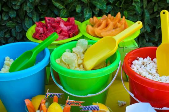 summer Beach Birthday Party decorations for food, shovels, buckets for serving