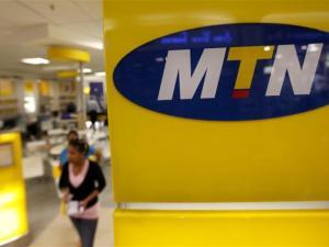 A customer leaves an MTN shop in Johannesburg