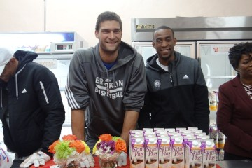 (l to r) Brooklyn Nets players Brook Lopez and Markel Brown work alongside Dr. Melony Samuels, executive director of The Bed Stuy Campaign Against Hunger