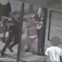 Video: Black Baltimore cop viciously beats Black man at bus stop