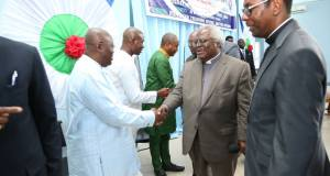 Rev. Martey in a handshake with Nana Akufo-Addo (in white attire)