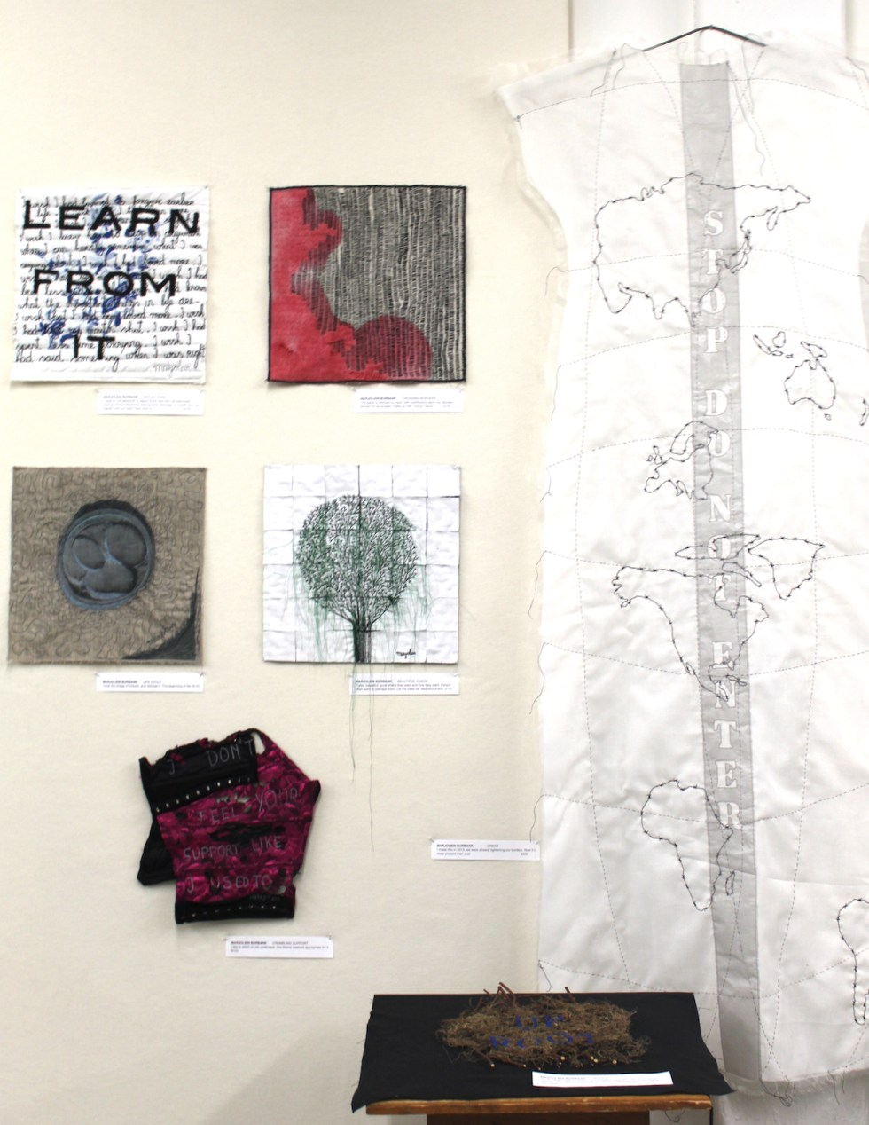 Marjolein Burbank: Reflections, Crossing Borders (Top row); Life Cycle, Beautiful Chaos (Middle row); Crumbling support (Bottom row), Roots (on pedestal) and The Dress
