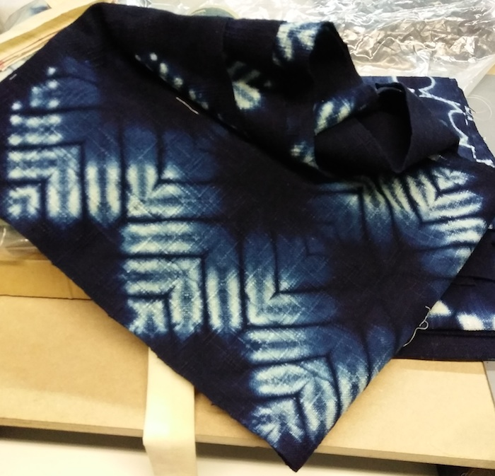Chevron indigo fabric dyed by Roland Ricketts shown during the Textile musem indigo workshop in toronto canada