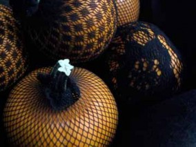 pumpkins wrapped in fishnet stockings