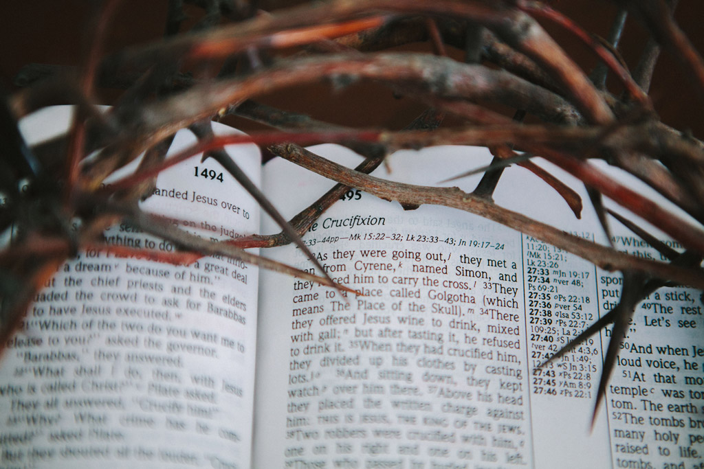 Crown of thorns on top of an open Bible