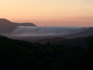 Photo by Robert Stull : Robert grabbed this beautiful shot of the clouds dropping over Bald Mountain as seen from the Blue Ridge Parkway. It almost looks like a waterfall.