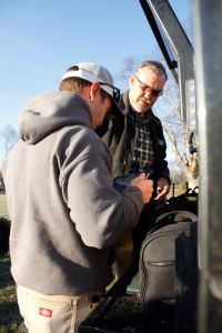 Ronnie Ponton with CVEC and Pilot Ryan Smith with Aerial Solutions do a radio communications check before he takes off Monday morning - March 20, 2017