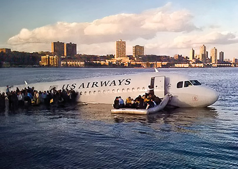 Airline passengers leave a US Airways Airbus 320 jetliner that safely ditched in the frigid waters of the Hudson River in New York on Jan. 15, 2009, after a flock of birds knocked out both its engines. (Associated Press photo/Janis Krums)