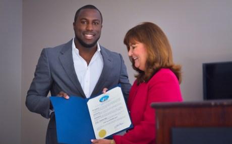 Mayor Susan Haynie presents Jozy Altidore with his proclamation. | Photo by: Kristen Altus