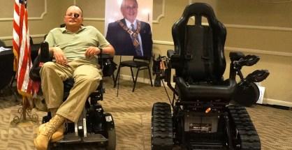 Navy Veteran Peter Reid, 54, and his new art track motorized wheelchair.